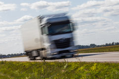 Truck transport on the road with motion blur. Blurred image back. Ground. Colorful wallpaper with copy space Royalty Free Stock Images
