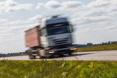 Truck transport on the road with motion blur. Blurred image back. Ground. Colorful wallpaper with copy space Stock Image