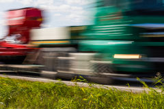 Truck transport on the road with motion blur. Blurred image back. Ground. Colorful wallpaper with copy space Stock Photos