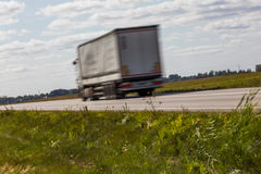 Truck transport on the road with motion blur. Blurred image back. Ground. Colorful wallpaper with copy space Stock Photo