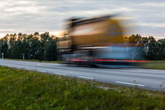 Speeding motion blur oncoming trucks with glowing lights on the royalty free stock photo
