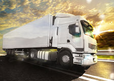 Truck transport. White truck on the road with the landscape at sunset Royalty Free Stock Images
