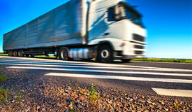 Truck transportation. Wide angle view and blurred motion effect Royalty Free Stock Image