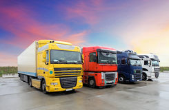Truck, transportation. Four Truck, transportation at sunset Royalty Free Stock Image