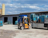 Truck for transportation of gas cylinders. The car delivers gas to shops, restaurants and city dwellers. ForkLift unloading of a t