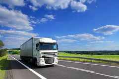 Truck transportation on the road. And clouds Royalty Free Stock Photos