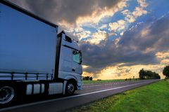 Truck transportation at sunset. Truck transportation on the road at sunset stock photos