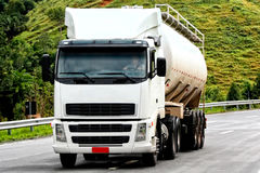 Truck transporting. On the highway Royalty Free Stock Images