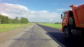 Truck transporting asphalt on the route of Altai. Altai Republic, Russia - July 14, 2015: truck transporting asphalt on the route of the Altai Krai stock footage