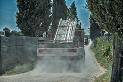 Truck transporting materials on a dusty road Royalty Free Stock Photography