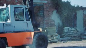 truck is transporting sandstone slabs at a stone warehouse