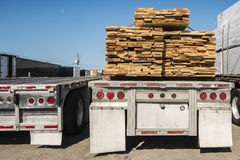 Truck transporting wood. Truck transporting plank of woods with a nice blue sky Royalty Free Stock Images