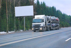 Truck transports car Stock Photo