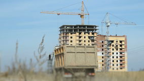 Truck transports the clay to the construction site. The truck transports the clay to the construction site of a large construction of a apartment residential stock footage