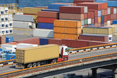 Truck transports container near the sea Royalty Free Stock Images