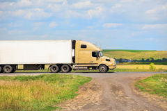 Truck transports freight. On country highway in summer Stock Photo