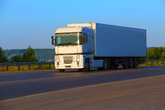 Truck transports freight on highway royalty free stock photo