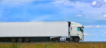 Truck transports freight on highway Stock Photos