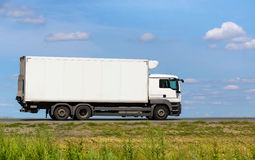 Truck transports freight on highway Royalty Free Stock Photos