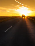 Truck traveling at sunset Stock Photo