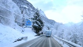 The truck is traveling on a winter road in the mountains of Norway. Shevelev. The truck is traveling on a winter road in the mountains of Norway. Rear view of stock footage