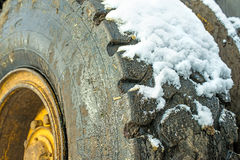 Truck tyre with snow Stock Photos