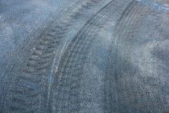Truck tyre trace. S on new asphalt stock image