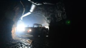 Truck underground mining gold tunnel geology. Moving driving stock video