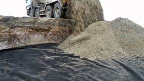 Truck unload gravel. The truck unload the gravel stock photos