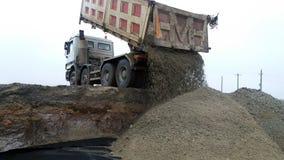 Truck unload gravel. View of dump truck dumping gravel Stock Image