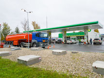 Truck unload petrol on filling station BP at day time Stock Photos