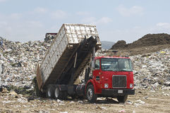 Truck Unloading Garbage At Site Royalty Free Stock Photography