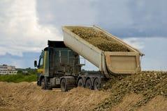 Truck unloading gravel Stock Images