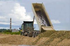 Truck unloading gravel Royalty Free Stock Image