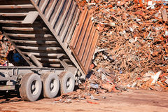 Truck unloading metal scrap Royalty Free Stock Photo