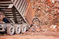 Truck unloading metal scrap royalty free stock photo