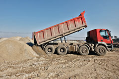 Truck unloading sand Royalty Free Stock Photography