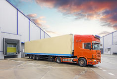 Truck in unloading in warehouse Stock Images