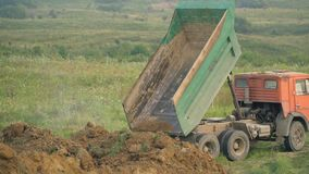 The truck unloads the land. In the open air stock footage