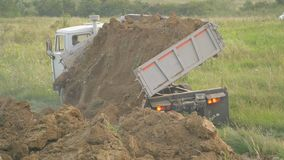 The truck unloads the land. In the open air stock video footage