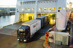 Truck unshipping from cruise boat. Truck unshipping from Turku-Stockholm cruise boat, destination Stockholm royalty free stock photo