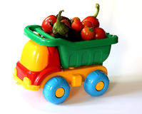 Truck with a vegetables. Toy plastic truck with some vegetables Royalty Free Stock Images