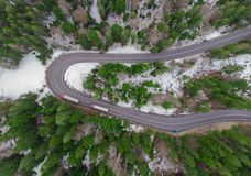 Truck vehicle driving in the forest road. aerial photo. Truck vehicle driving in the forest road landscape. aerial photo from the drone stock image