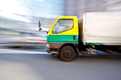 Truck Vehicle in motion blur. Truck vehicle car group  in motion blur while moving at a fast speed down the street Royalty Free Stock Photo