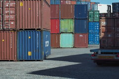 Truck waiting on yard to unload a container. Royalty Free Stock Photography