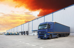 Truck, warehouse building stock images