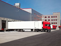 Truck warehouse logistic. Cargo trucks at an entrance of a warehouse royalty free stock photo