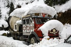 The truck was covered with snow. Because in the cold winter Stock Image