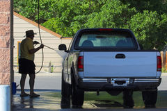 Truck Wash. An elderly man is washing his newly purchased pickup Royalty Free Stock Photography