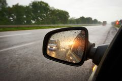 Truck in a rear view mirror at sunset Royalty Free Stock Images